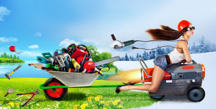 Creative girl rides a heat gun. And takes a trolley with different tools royalty free stock photo