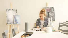 Creative girl working with pastel crayon. In home studio stock video footage