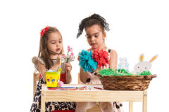 Creative girls making easter decorations Stock Image