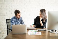 Creative graphic designer and coworker Royalty Free Stock Images