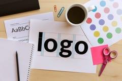 Creative graphic designer desk. Logo design concept. Flat lay stock images
