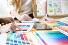 Creative Graphic designer at work. Color swatch samples pantone. Palette in studio modern office, interior design, renovation and technology concept stock photography