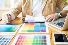 Creative Graphic designer at work. Color swatch samples pantone. Palette in studio modern office, interior design, renovation and technology concept royalty free stock images