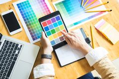 Creative Graphic designer at work. Color swatch samples pantone. Palette in studio modern office, interior design, renovation and technology concept royalty free stock photos