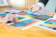 Creative Graphic designer at work. Color swatch samples pantone. Palette in studio modern office, interior design, renovation and technology concept stock images
