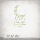 Creative graphics with camels in the desert on grungy background. For Islamic Festival of Sacrifice of Eid-Al-Adha celebration. Vector illustration Stock Photo