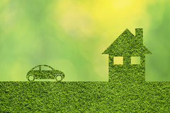 Creative green illustrated eco house and eco car. Icon textured with grass effect. Creative modern eco healthy home house on blurred bokeh yellow green Royalty Free Stock Photography