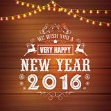 Creative greeting card for Happy New Year 2016. Creative greeting card design decorated with lights on stylish wooden background for Happy New Year 2016 Royalty Free Stock Photo