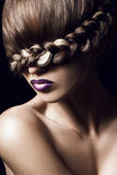 Creative hairstyle. Close-up portrait of young woman with creative hairstyle royalty free stock images