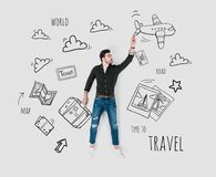 Creative hand drawn collage with man. And various travel signs Stock Photos