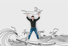 Creative hand drawn collage with man riding surfboard and carrying dachshund dog Stock Photos