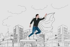 Creative hand drawn collage with man in superhero cape flying over city Stock Photo