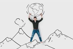 Creative hand drawn collage with strong man carrying earth Stock Photo