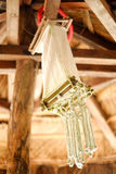 Creative hand made light chandelier decoration hanging from the ceiling Royalty Free Stock Photos