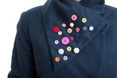 Creative handicraft with colored buttons stitched on jacket coll Royalty Free Stock Image