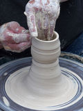 Creative Hands. Potter creating edges and curves on a clay creation stock image