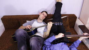 Creative happy couple playing guitar stock video