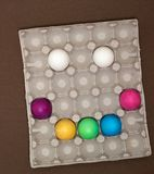 Creative happy smiley face. Easter eggs in tray royalty free stock image