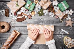 Creative hobby. Christmas presents with tools and decorations. Packing presents on wooden table, top view. Royalty Free Stock Image