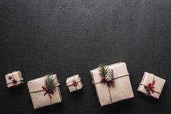 Creative hobby. Packaging modern christmas present boxes in stylish brown paper with ribbon. Stock Photography