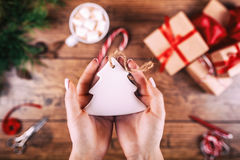 Free Creative Hobby. Woman S Hands Show Christmas Holiday Handmade Christmas Tree Toy. Scissors On Wooden Table, Top View Stock Photos - 80052733