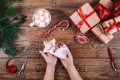 Creative hobby. Woman's hands show christmas holiday handmade Christmas tree toy. Scissors on wooden table, top view Royalty Free Stock Photos