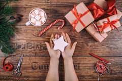 Creative hobby. Woman's hands show christmas holiday handmade Christmas tree toy. Scissors on wooden table, top view Royalty Free Stock Photography