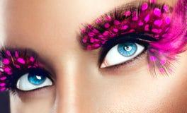 Creative holiday makeup. False long purple eyelashes closeup Royalty Free Stock Photography