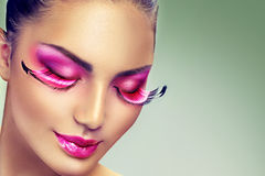 Creative holiday makeup with false long purple eyelashes Royalty Free Stock Photography