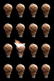 Creative Idea - Bulb. Image of wrapped light bulbs with one bulb open, conceptual creativity and realising your ideas royalty free stock photos