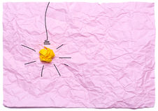 Creative idea with burning light bulb on a pink crumpled background. Education concept.  Stock Image