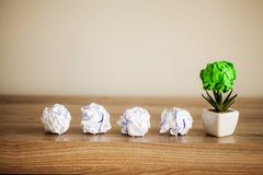 Creative idea concept.Inspiration, New idea and Innovation concept with Crumpled Paper on wood background.  royalty free stock photo