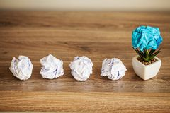 Creative idea concept.Inspiration, New idea and Innovation concept with Crumpled Paper on wood background.  stock image