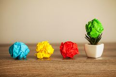 Creative idea concept.Inspiration, New idea and Innovation concept with Crumpled Paper on wood background.  stock photos
