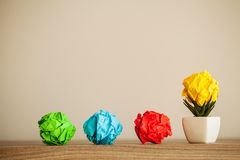 Creative idea concept.Inspiration, New idea and Innovation concept with Crumpled Paper on wood background.  stock images