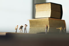 Creative idea concept - miniature photographer with vintage gold Stock Photos