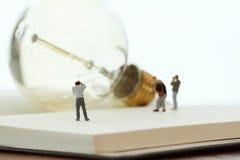 Creative idea concept - miniature photographer Stock Photos