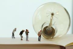 Creative idea concept - miniature photographer Royalty Free Stock Photos