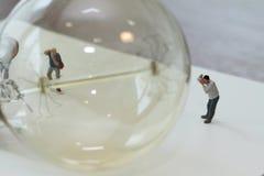Creative idea concept - miniature photographer Royalty Free Stock Images