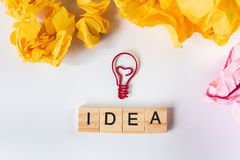 Creative idea and innovation concept  with light bulb and paper Royalty Free Stock Photo