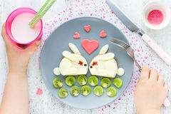 Creative idea for kid breakfast - cheese sandwich shaped cute wh Stock Image