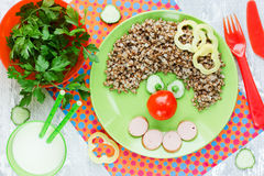 Creative idea for kids dinner or breakfast - buckwheat with saus Stock Photos
