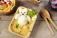 Creative idea for kids lunch or dinner. Children animal food. Bath with rice bear and cream soup. Mushrooms of radishes Stock Photo