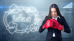 Creative ideas concept, boxing businesswoman standing on fight pose on painted background near idea organizational chart. Creative ideas concept, beautiful Royalty Free Stock Photo