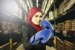 Creative ideas concept, successful young muslimah businesswomen with boxing glove over abstract double exposure background Royalty Free Stock Image