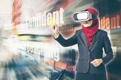 Creative ideas concept, successful young muslimah businesswomen wearing virtual reality headset  over abstract double exposure bac Royalty Free Stock Image