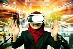 Creative ideas concept, successful young muslimah businesswomen wearing virtual reality headset  over abstract double exposure bac Royalty Free Stock Photos