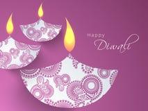 Creative illuminated lit lamps for Happy Diwali celebration. Royalty Free Stock Image