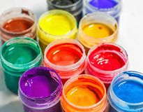 Creative image, group of tubes with gouache paint on a light bac stock photos