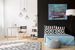 Creative interior design. Cozy creative studio apartment with bed, desk and computer Stock Photos